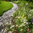 Stock Photo: Wildflower garden and path to gazebo