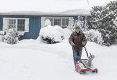 Man using snowblower — Stock Photo