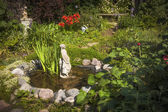 Garden pond with statue — Stock Photo