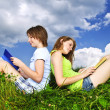Girls reading outdoors — Stock Photo