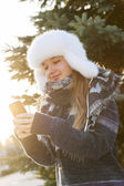 Young girl with cell phone — Stock Photo