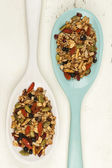 Homemade granola in spoons — Stock Photo