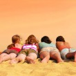 Four girls at orange sea — Stock Photo #4826010