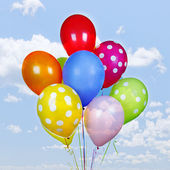 Colorful balloons on blue sky — Foto de Stock