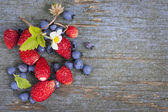 Berries on wood background — Stock Photo