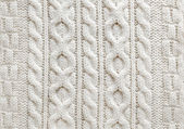 Cable knit fabric background — Stock Photo