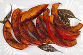 Roasted pumpkin on plate — Stockfoto