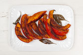 Roasted pumpkin on plate — Stock Photo