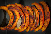 Roasted pumpkin slices — Stock Photo