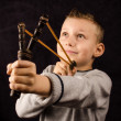 Boy with slingshot — Stock Photo #14648655