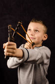 Boy with slingshot — Stock Photo