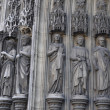 The statues of Saints, supporting the arch of entrance to the Church of Saint-Laurent — Stock Photo