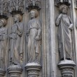The statues of Saints, supporting the arch of entrance to the Church of Saint-Laurent — Stock Photo #34594297