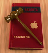 Gavel on a book of patents — Stock Photo