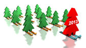 Green Christmas trees skiing with the red leader — Stock Photo