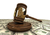 Judge's gavel standing on a dollars — Stock Photo