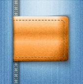 Braunes leder-etikett auf blaue jeans-hintergrund — Stockvektor