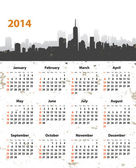 2014 year stylish calendar on cityscape background — Stock Vector