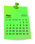 Calendar for may 2014 on green sticky note attached with green p — Stock Vector
