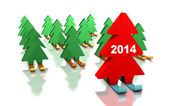 Green Christmas trees skiing with the leader — Stock Photo