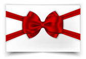White gift card with red ribbon and bow — Stockvector