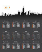 2015 year stylish calendar on cityscape background — Stock Vector