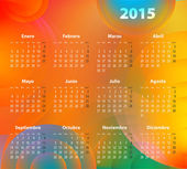 Spanish Calendar for 2015 on abstract circles background — Stock Vector