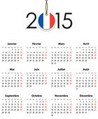 French Calendar grid for 2015 with flag like tag — Stock Vector