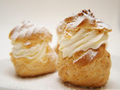 Choux pastry buns, filled — Stock Photo