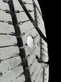 Screw in tire — Stock Photo