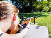Young female shooter — Stock Photo