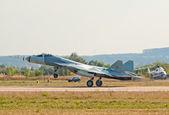 PAK FA T-50 jet lands — Stock Photo
