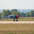 "Photo: T-6 ""Texan"" trainer plane runs for takeoff"