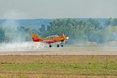 Yak-52 plane lands — Stock Photo