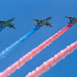 Stock Photo: Su-25 planes fly with smoke trails