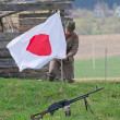 Soldier raises Japanese flag — Stock Photo