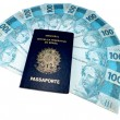New currency from Brazil and brazilian passport — Stock Photo
