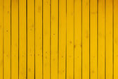Yellow wooden background — Stock Photo