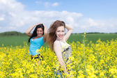 Two women in agricultural fields. — Стоковое фото