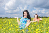 Two women in agricultural fields. — Stock Photo