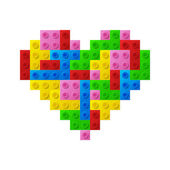 Heart from plastic toy blocks. — Stock Vector