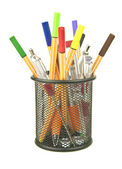 Colouring pens and junk in desk tidy — Stock Photo