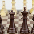 Chess pieces in soft focus — Stock Photo