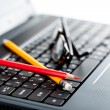 Stock Photo: Laptop keyboard and pencills and glasses