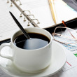 Close-up of documents, pen, cup of coffee on the table — Stok fotoğraf