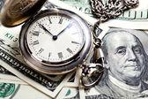 Money and clock — Stock Photo