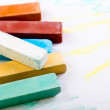 Chalks in a variety of colors arranged on a white background - 图库照片