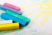 Chalks in a variety of colors arranged on a white background — Stockfoto