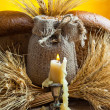 Candle and ears of wheat - Stock Photo