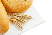 Bread and spikelets — Stock Photo